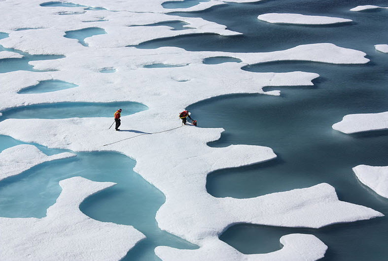 Melt ponds on sea ice in the Arctic. Snow has been melted away to form pools which can let through light.