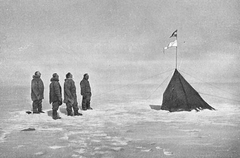 Members of Roald Amundsen's South Pole expedition 1910-12 at the pole itself, December 1911, (from left to right): Roald Amundsen, Helmer Hanssen, Sverre Hassel and Oscar Wisting. Source Wikipedia.